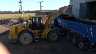 CAT 966H Wheelloader loading dump trucks