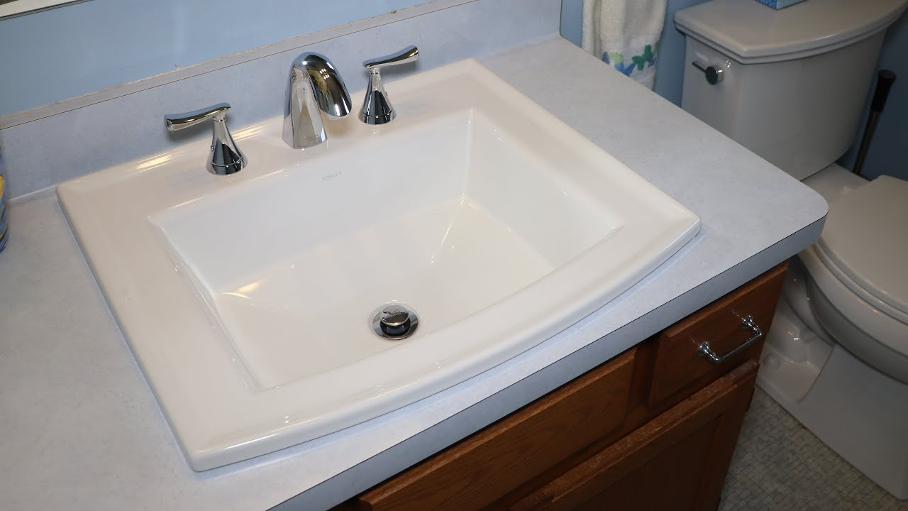 replacing the bathroom sink with a kohler archer sink and american standard chatfield faucet