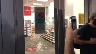 Protesters defend a Miami CVS against damage