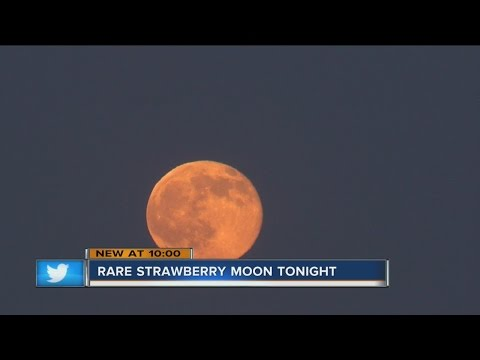 Strawberry moon rises during summer solstice