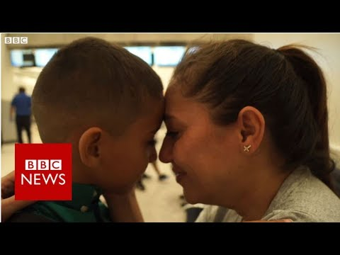 The moment a migrant mother is reunited with her son - BBC News