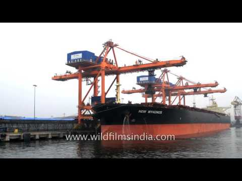 Coal containers being loaded onto New Mykonos ship at Visakhapatnam Port, india