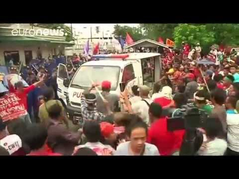 Philippine police van rams into activists outside U.S. embassy