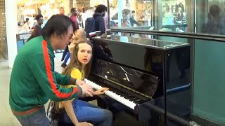 A Man in Green Interrupts Young Girl on the Piano with a Stunt That Causes a Crowd to Rush In