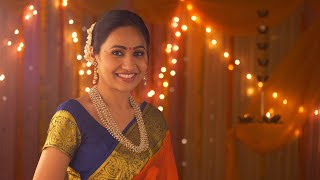 Indian beautiful woman dressed in ethnic wear smiling looking into the camera - Greeting