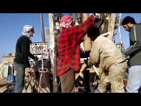 Drilling rig drilling a water well in middle east Jordan