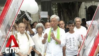 Elderly citizens in Hong Kong gather for silent march