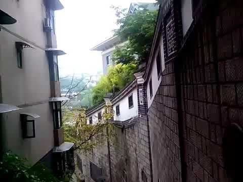 China, Chongqing, city on hills.