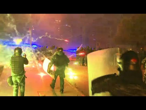Lebanon's protesters use fireworks during clashes outside parliament
