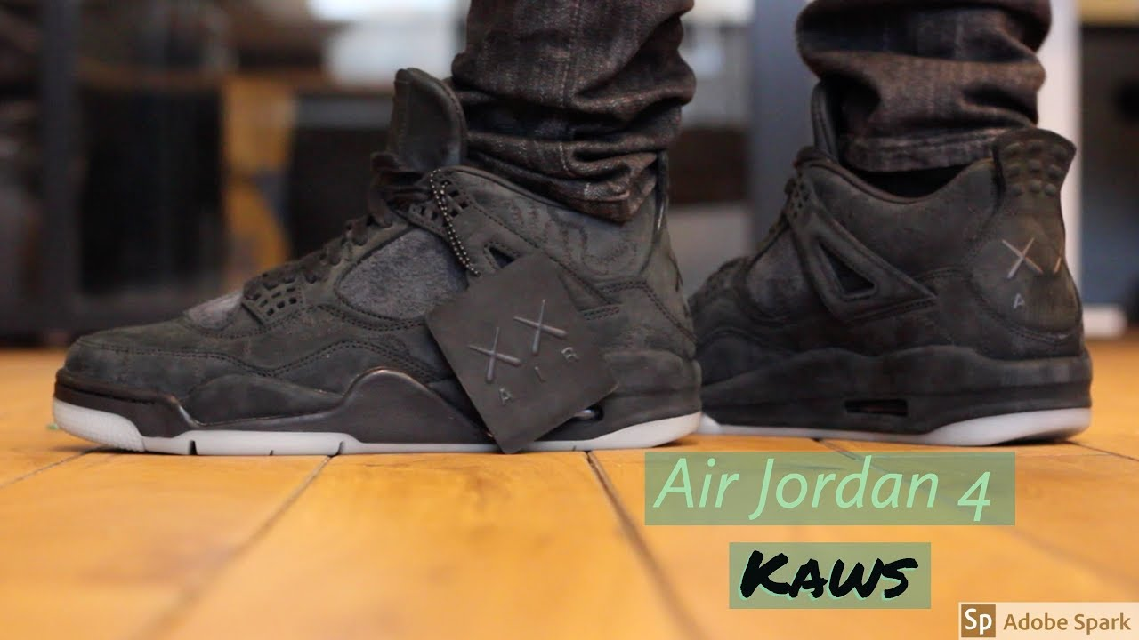 timeless design 96ec5 546ad Air Jordan 4 Kaws Black Review + On Feet