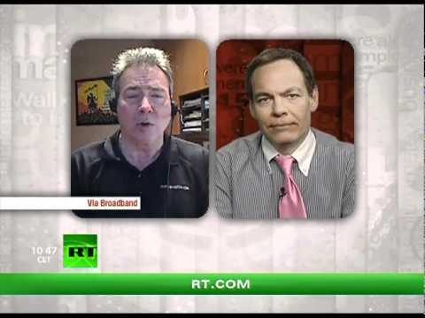 Keiser Report: Spiral of debt towards the paranormal (E233)