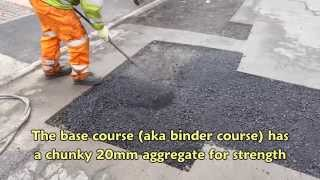 Tarmacadam patch repair in residential road