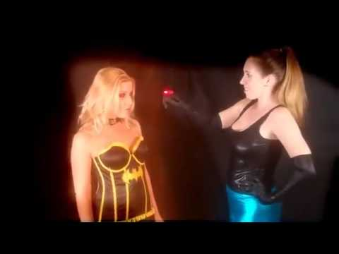Superhero hypnotize by girl
