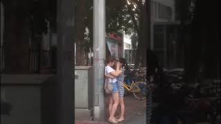 The two girls kiss in public