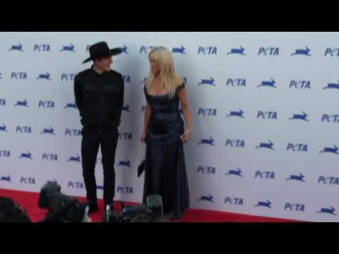 Pamela Anderson and Luke Gilford seen at PETA event Hollywood in Los Angeles, CA