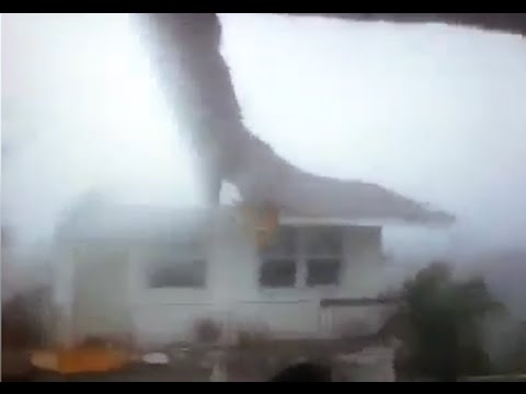 Hurricane Matthew rips off the roof of a house in the Bahamas as it makes its way to Florida