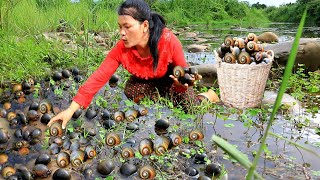 woman catch snail and cook snail for dinnerboil & fry snail with sugar for dogcooking in forest HD
