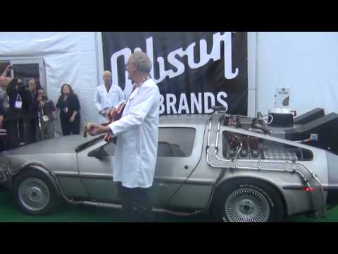 2014 CES Actor Christopher Lloyd with the Delorean and Gibson guitar from the movie