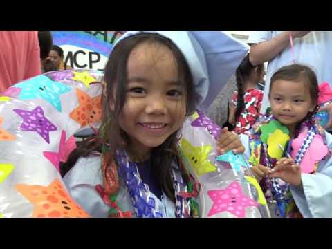17 St. Marianne Cope Preschoolers grad in caps and gowns