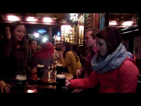 Students sitting enjoying traditional Irish culture and music in Belfast, Northern Ireland