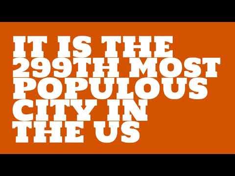 How does the population of Broken Arrow, OK compare to Manhattan?