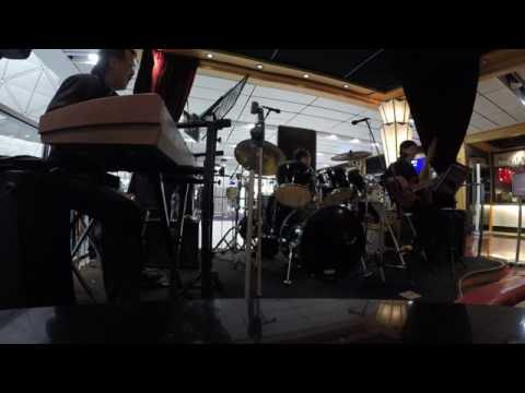 "Live at Cafe Deco Airport ""FLorida Straits"" by Spyro Gyra cover by The Three Brothers"