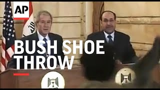 President Bush ducks as man throws shoes at him in protest