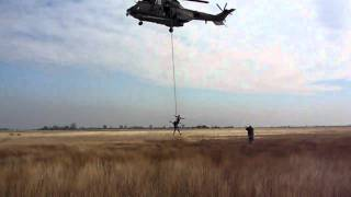 Fast rope descends and extraction from a military helicopter