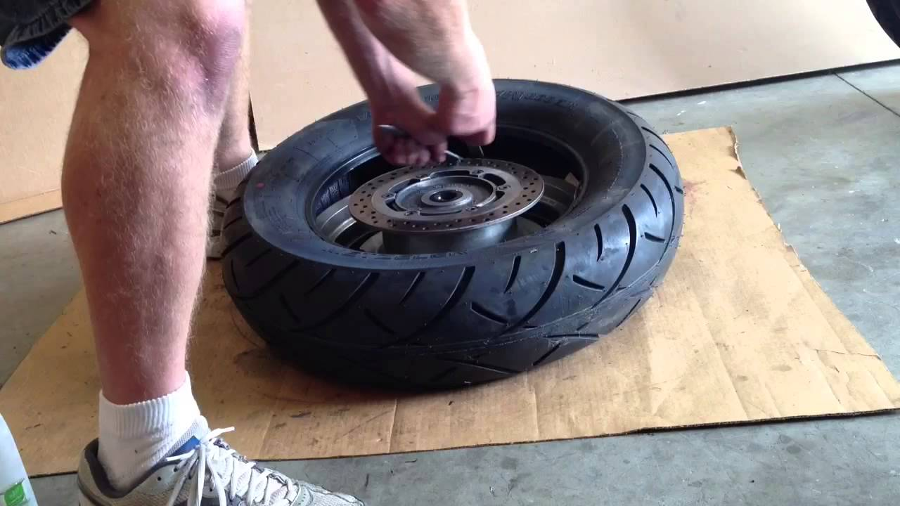 Removing and replacing a motorcycle tire from the rim