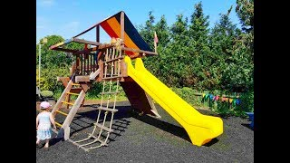 Outdoor Kids Playing in the Park Playground with Swing and Slide Climbing Having Fun Family Day Out