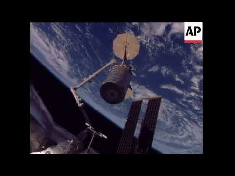 Unmanned cargo craft docks with space station
