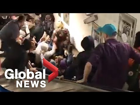 A.D. - Crowded Escalator Goes Way Too Fast and Causes a Pileup with Injuries
