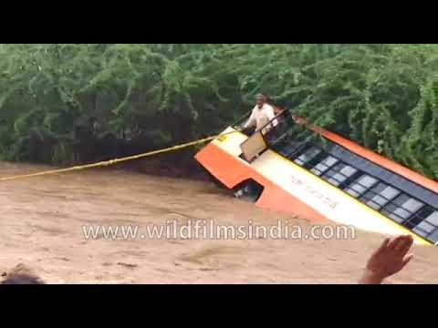 Monsoon stream takes the best of a bus at Gadag, Karnataka