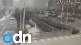 Woman drives into a river