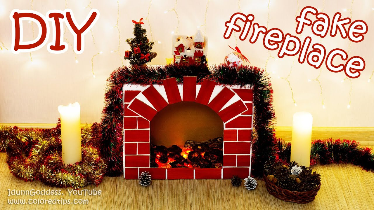 Diy fake fireplace with faux fire cozy room decor for How to decorate a fireplace for christmas