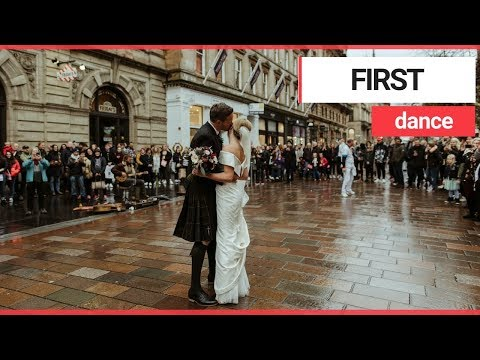 Newlywed couple enjoy first dance in Scotland's busiest shopping street | SWNS TV