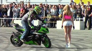 Biker Drifting Around Beautiful Girl