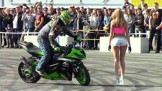 Biker Drifting Around Beautiful Girl
