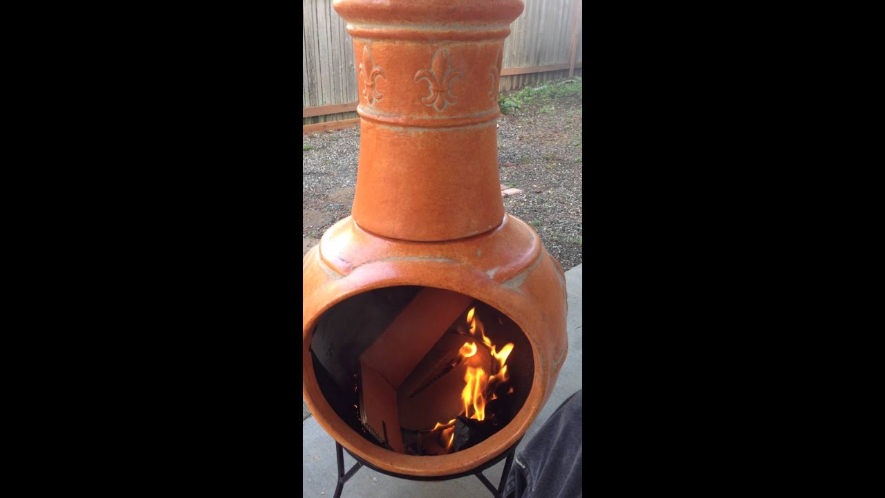 my first one in the new clay chimney outdoor fireplace. - YouTube