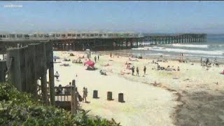 Large crowds fill San Diego County beaches during holiday