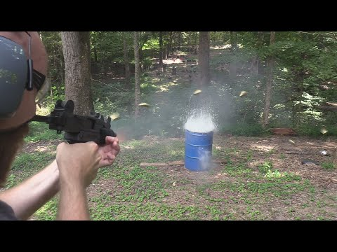mini-uzi-vs-water-barrel