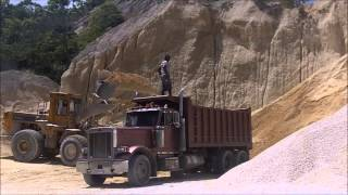 980C Caterpilar Front End Loader Loading A Peterbilt Dump Truck at Quarry