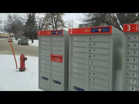 Picking Mail At The Community Mailbox