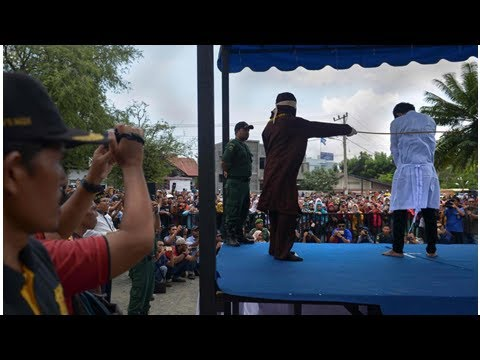 Couples whipped in Indonesia's Aceh for public show of affection