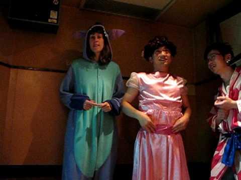 Jo and others doing costume karaoke