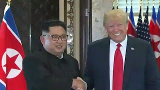 Trump and Kim Jong Un sign