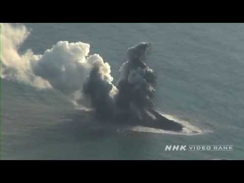 NHK VIDEO BANK - Aerial: Nishinoshima volcano erupting moment -