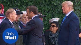 Donald Trump and Emmanuel Macron greet D-Day veterans