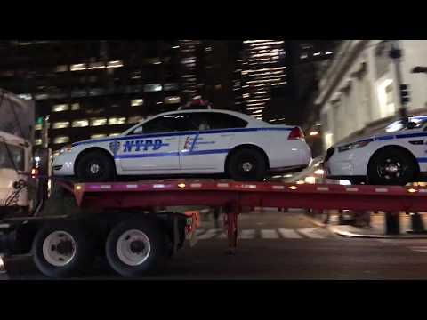 SEVERAL HOLLYWOOD, NYPD PROP CRUISERS, BEING TRANSPORTED ON E. 42ND ST. IN MIDTOWN, MANHATTAN, NYC.