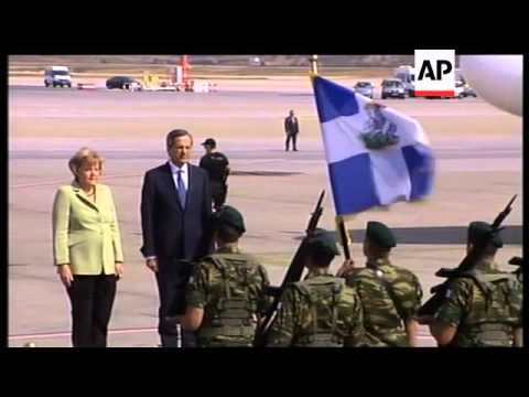 Massive protests as German Chancellor Merkel arrives in Greece